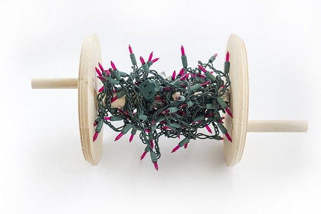 Wrap Christmas lights around a handmade spool
