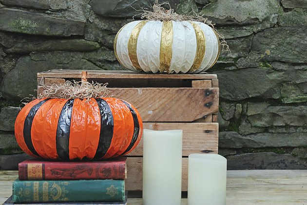 dryer vent pumpkins displayed on a wooden crate