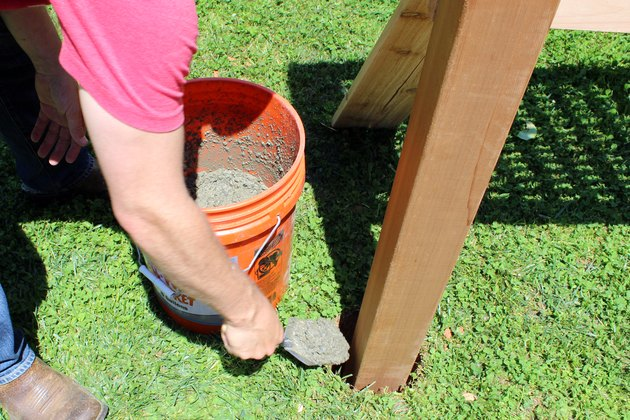 fill hole with concrete until flush with grass