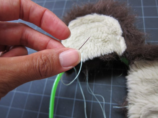 Whipstitch ears to headband