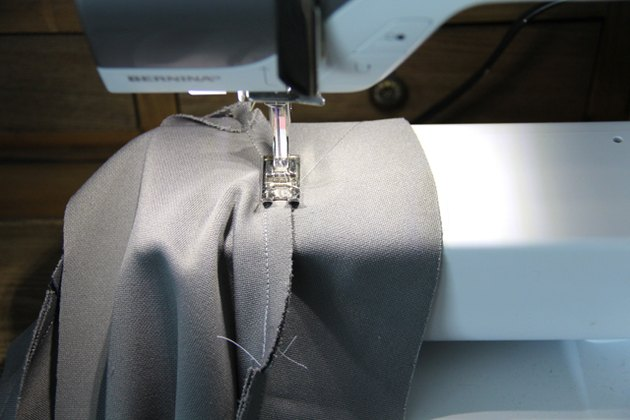 Sew the facing to the seam for secure neckline
