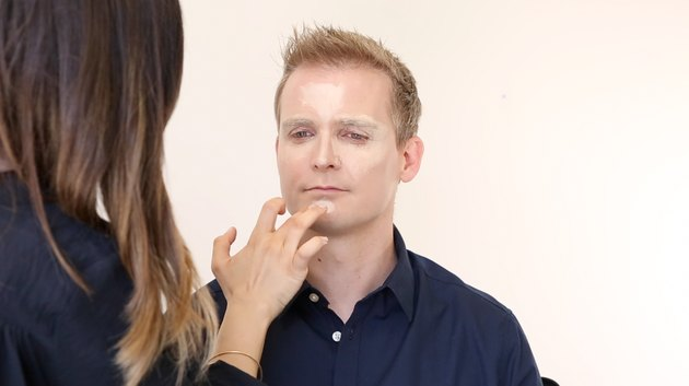 Applying concealer to chin