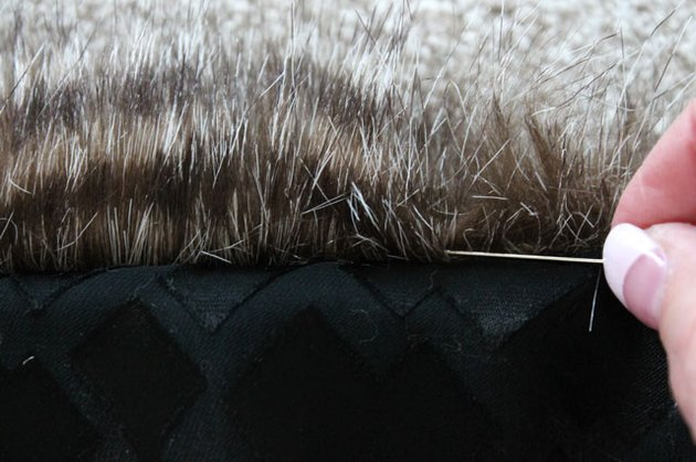 Use a pin to release any fur that is caught in the seam.