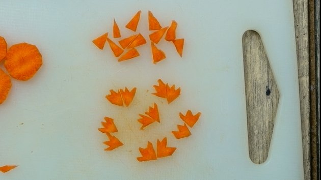 Cutting feet from carrot chips for deviled egg Easter chicks.