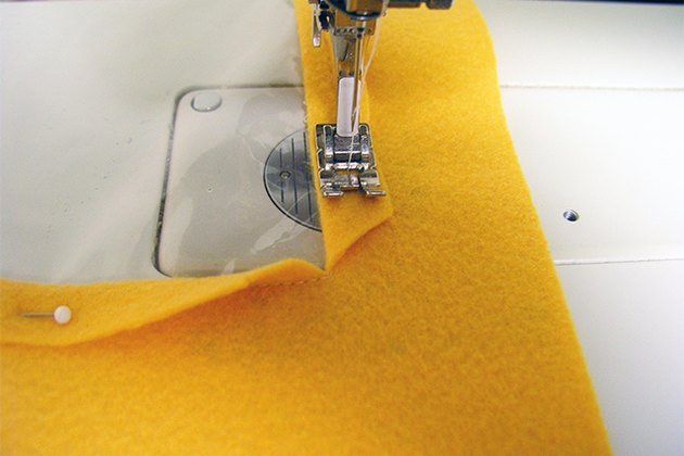 Stitching down the fold-over seam.