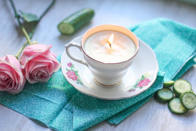 lit teacup candle
