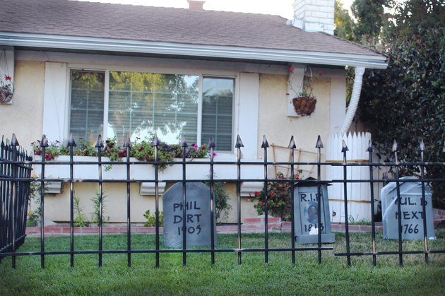 Cemetery fence installed in a front yard with cardboard tombstones