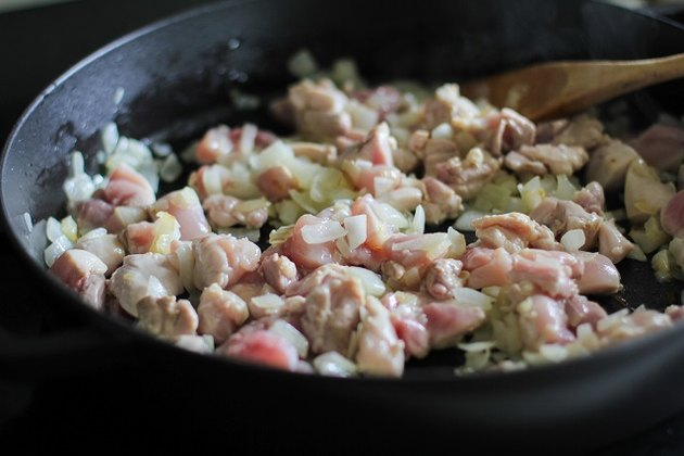 chicken and onion in a skillet