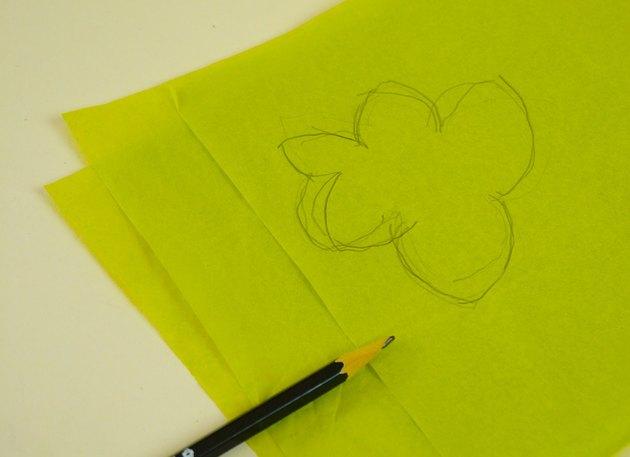 A pumpkin leaf drawing on green tissue.