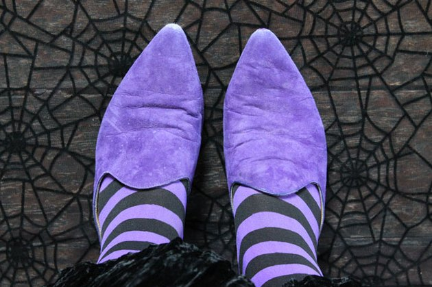 purple witch shoes and striped tights