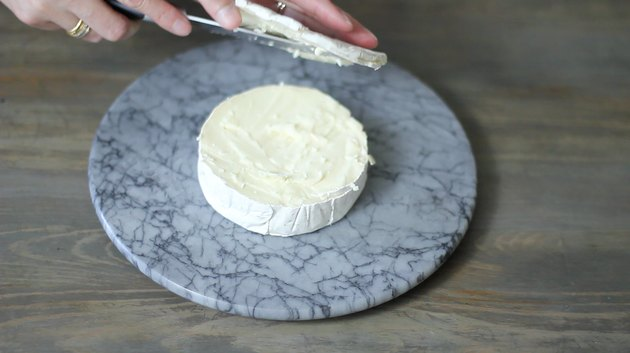 slicing top off brie