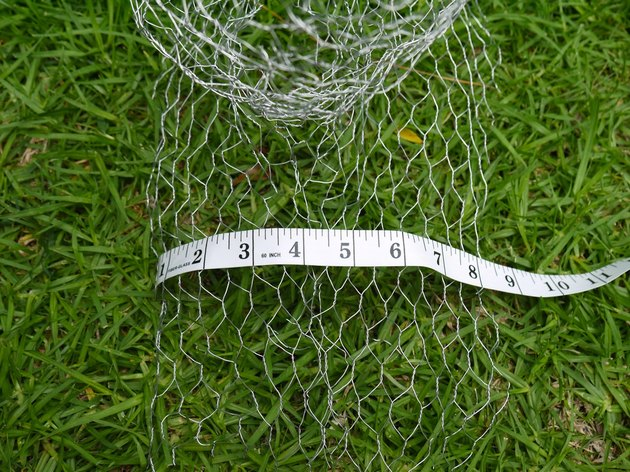 A measuring tape measuring 8 inches over the shoulders.
