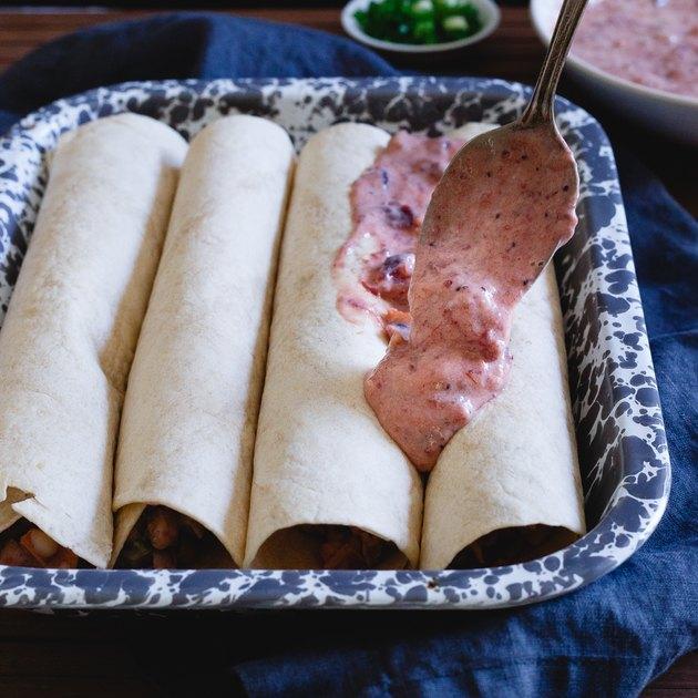 Cranberry salsa sour cream enchilada sauce tops these Thanksgiving leftover enchiladas