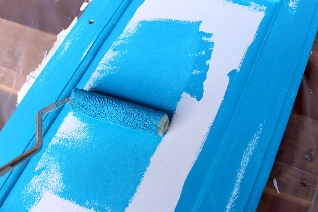 apply your paint color with roller brush | How to Paint Oak Bathroom Cabinets