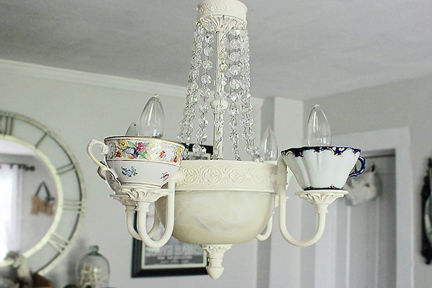 Attach the wiring to the ceiling outlet and hang the chandelier on a sturdy hook.