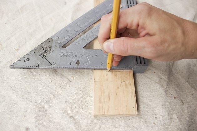 Measuring 3/4 inch width of shelves.
