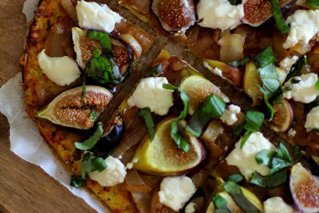 Gluten-free cauliflower crust pizza with caramelized onions, figs, ricotta, and basil.