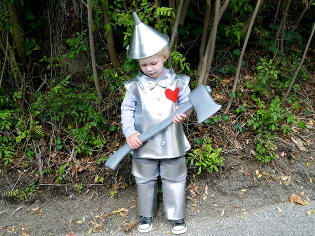 little boy dressed in tin man costume