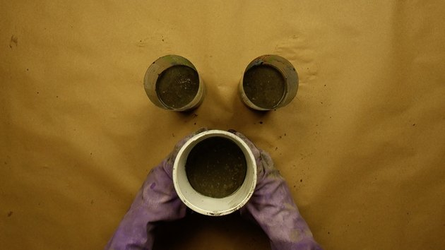 Shaking bubbles out of wet cement mix for DIY candles with cement base project