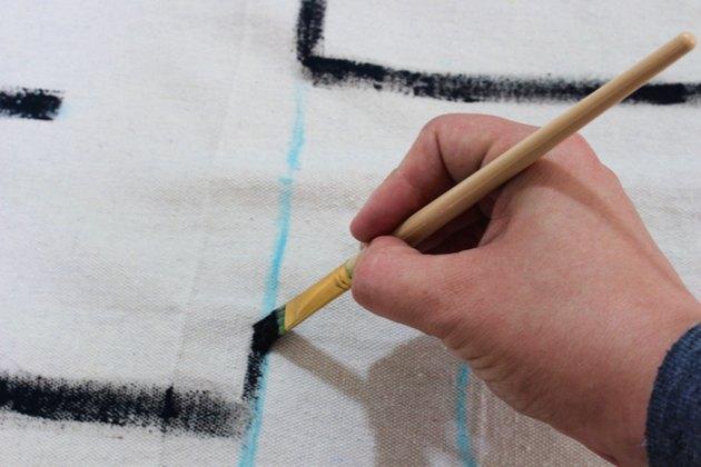 paint chalk paintbrush drop cloth hand