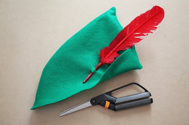 Add a red feather to the hat.