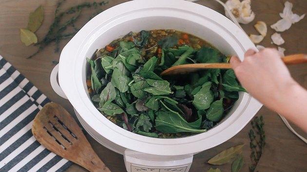 Adding baby kale to crockpot