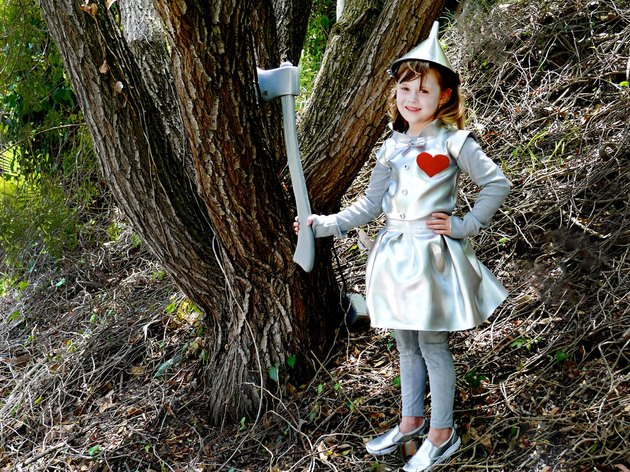little girl dressed in tin man costume
