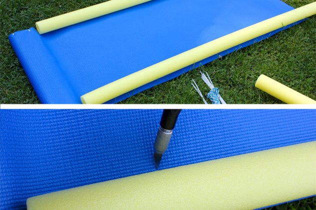 Lay the pool noodle along the length of the yoga mat and create five holes along the edge os the noodles on each side.