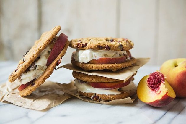 A stack of ice cream sandwiches next to a peach