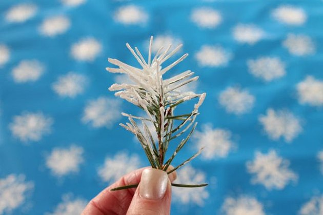 Make snowflake wrapping paper with a pine branch