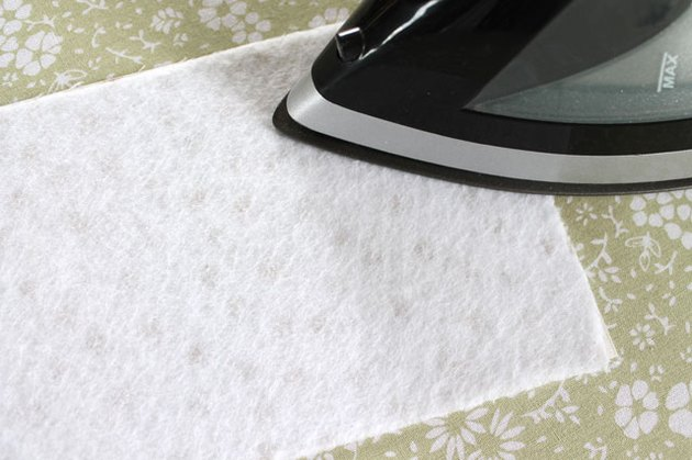 Use an iron to fuse the fleece to the fabric.