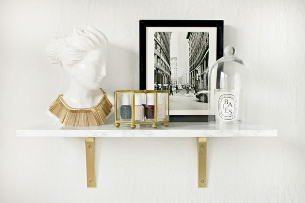 Faux marble shelf with gold brackets