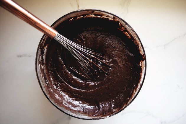 Mix in the liquid ingredients until the batter is thick and glossy.