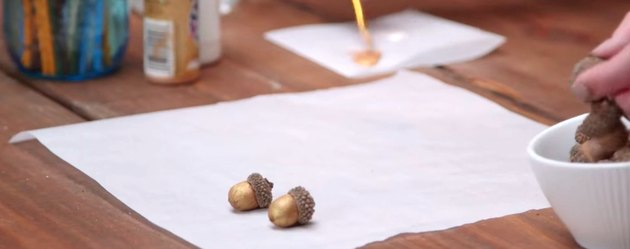 Acorns decorated with gold paint