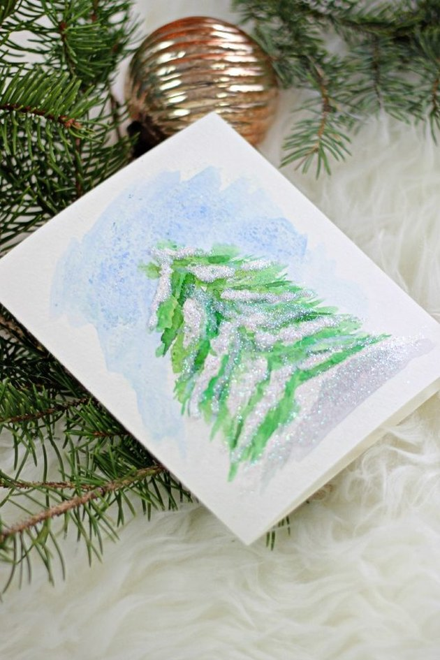 Paint a simple snowy pine with watercolors