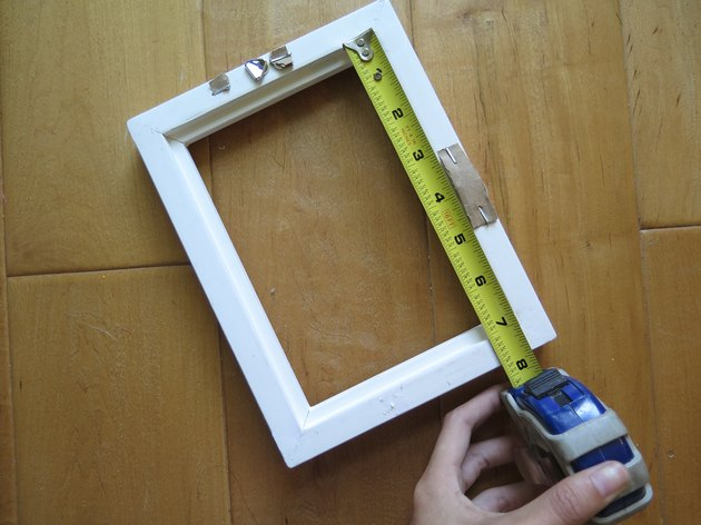 Measure the longest side of the back of the frame.