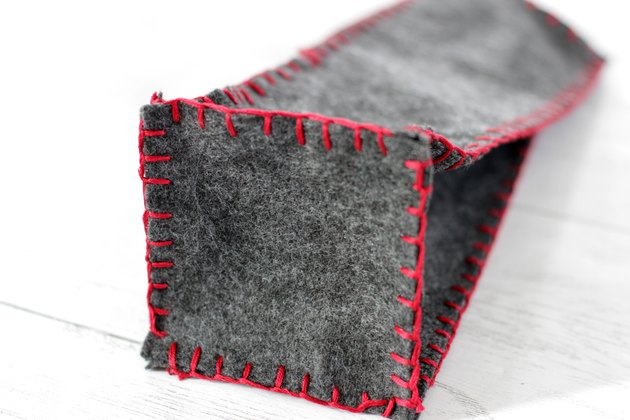 use a blanket stitch to attach square to bottom