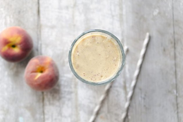 An aerial view of a peaches and cream smoothie.