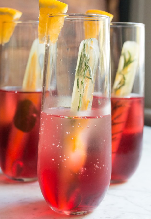 Rosemary and citrus ice cubes in a cranberry cocktail