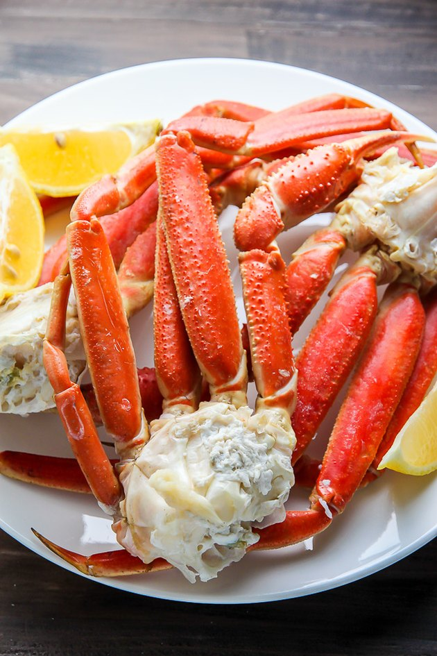 Serve crab legs warm with butter.