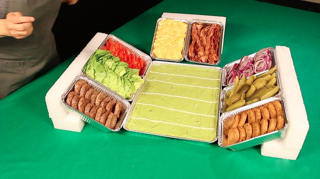 filling trays with burgers and toppings