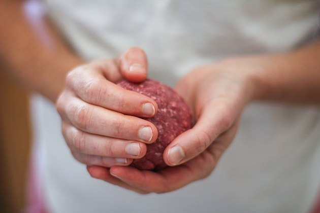 ball of meat in hands
