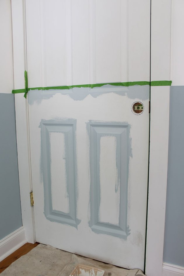 Painting the panels of the interior door.