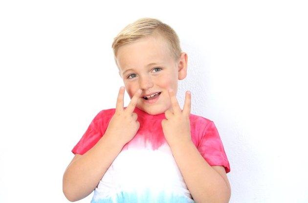 Kid wearing tie dye shirt.