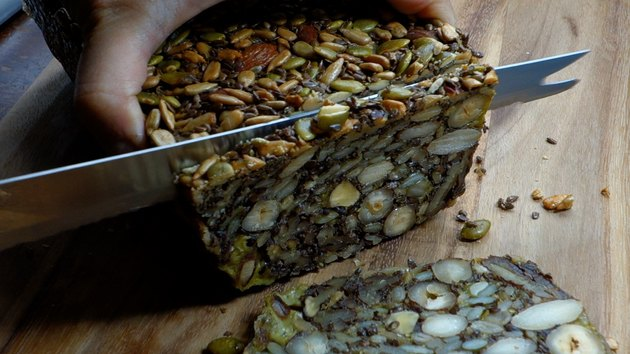 Slicing grain free, paleo-friendly Nordic Stone Age Nut Bread.