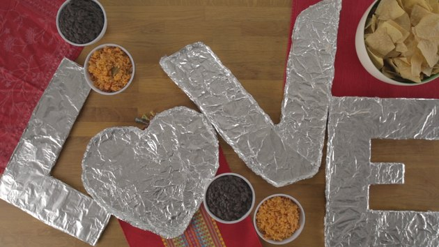 Cardboard letters covered in foil.