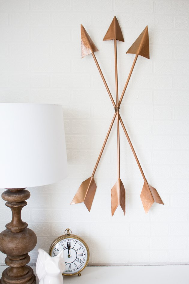 Copper arrows wall art