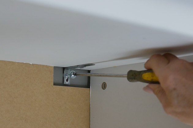 install screw into hollow wall anchor