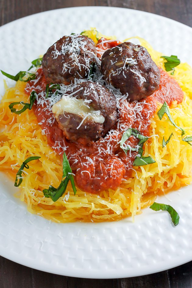 Shredded spaghetti squash used as a base for meatballs and sauce.