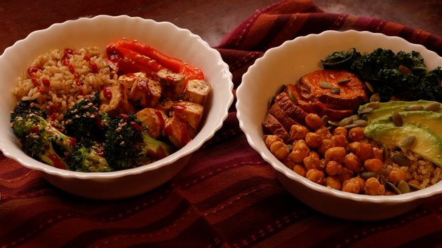 Two Buddha bowls: one with tofu broccoli and rice, another with chickpeas, avocado, quinoa, and sweet potato